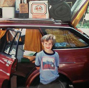 On the road for a family vacation in Yellowstone, often crammed in the back of a tiny Datsun station wagon with my younger brother.