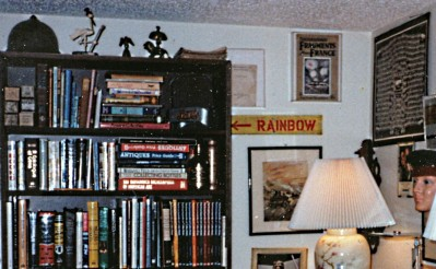An original WWI Rainbow Division trench sign hanging on the back wall