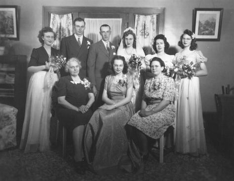 A photo from my grandparents' — Raymond 'Ray' Hill and Marilyn Hay — wedding at the family homestead near Lake Preston, South Dakota. (front row: Geneva Estella Darling Hay, Azalea Hay Davis | back row: Everett Hay, Raymond 'Ray' Hill, Marilyn Hay Hill, Grace Leek Hay, Grace Hay Stucke